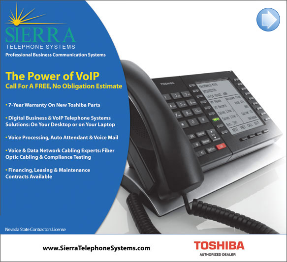 Sierra Telephone Systems, Inc. phones on display around computer